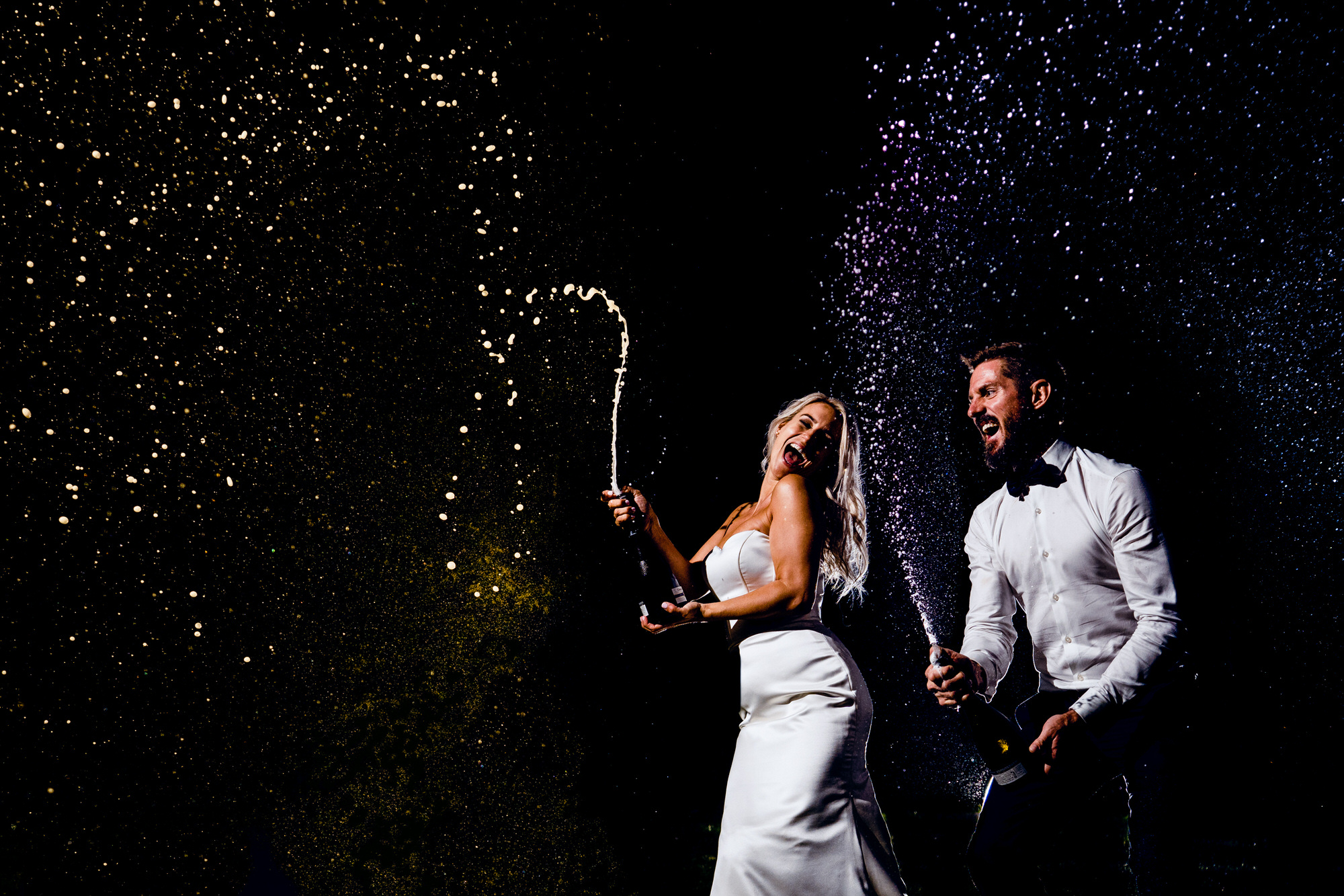 Chaucer Barn Couple Spraying Champagne