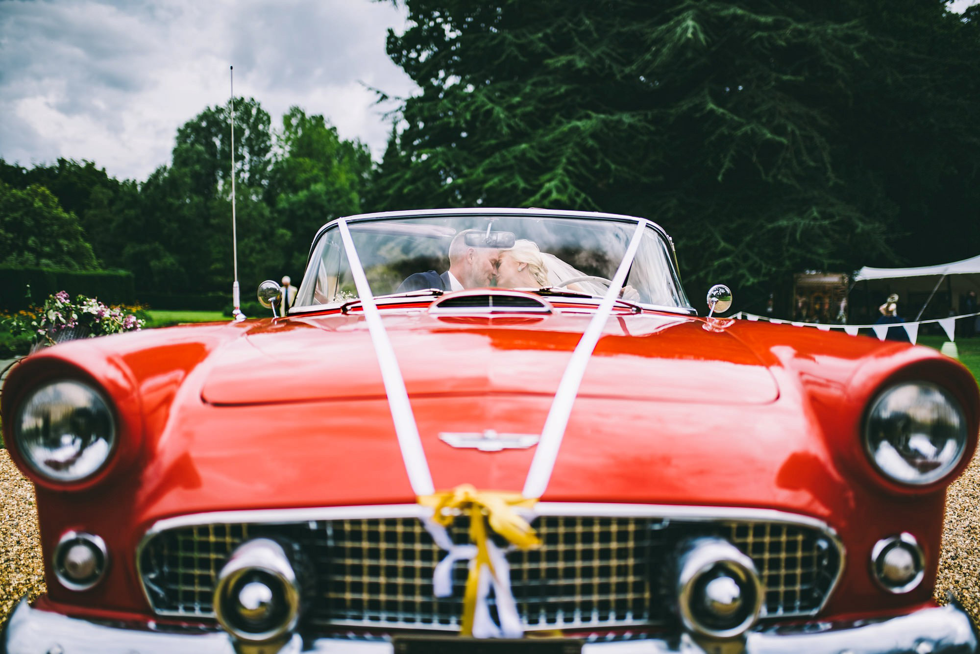Bride and Groom in car at Mannington Hall